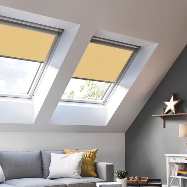 Two skylights in a white and grey decorated bedroom